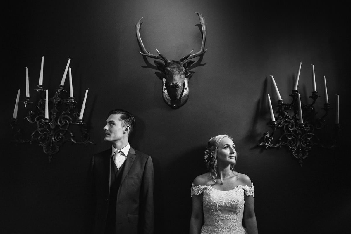 alternative couples portrait with a deer head